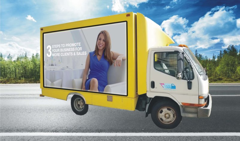 Yellow Truck 1 e1542340642235 - Mobile Billboard Services